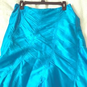 Turquoise mermaid styled skirt.